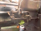 John Deere E hit and miss engine with rebuilt ignitor burning off excess oil in crankcase .wmv