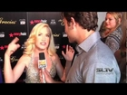 Angela Kinsey shows off her dance moves on the red carpet