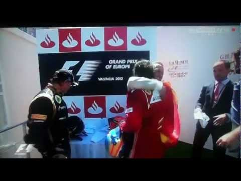 Michael Schumacher and Fernando Alonso Share A Hug - Valencia GP 2012 | PopScreen