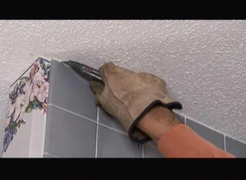 Removing ceramic tile from wall