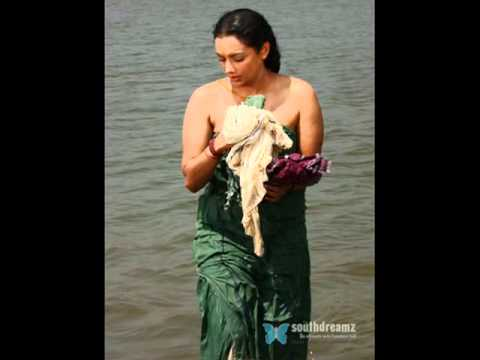 ... village-hot-aunty-washing-clothes-after-bath-in-river-.jpg
