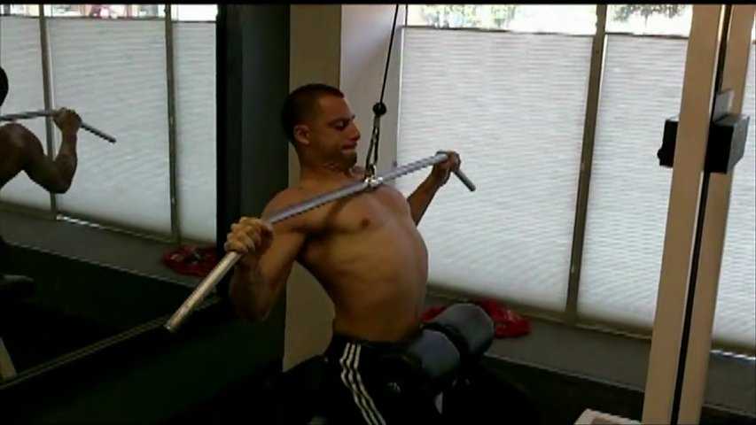 Wide Grip Lat Pull-Downs   Back Exercises   PopScreenWide Grip Pull Downs